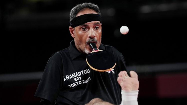 Armless table tennis player who holds racket in mouth is inspiration at Paralympics