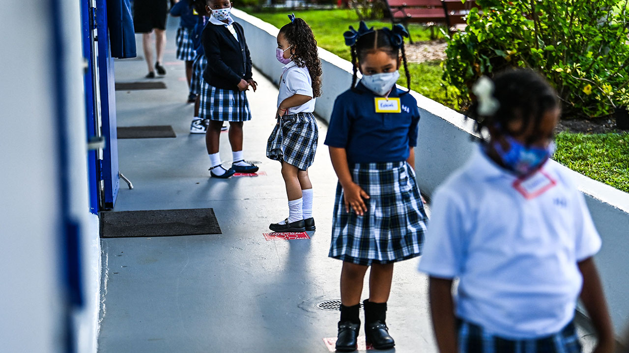 Do school mask bans violate civil rights? Feds investigate 5 states